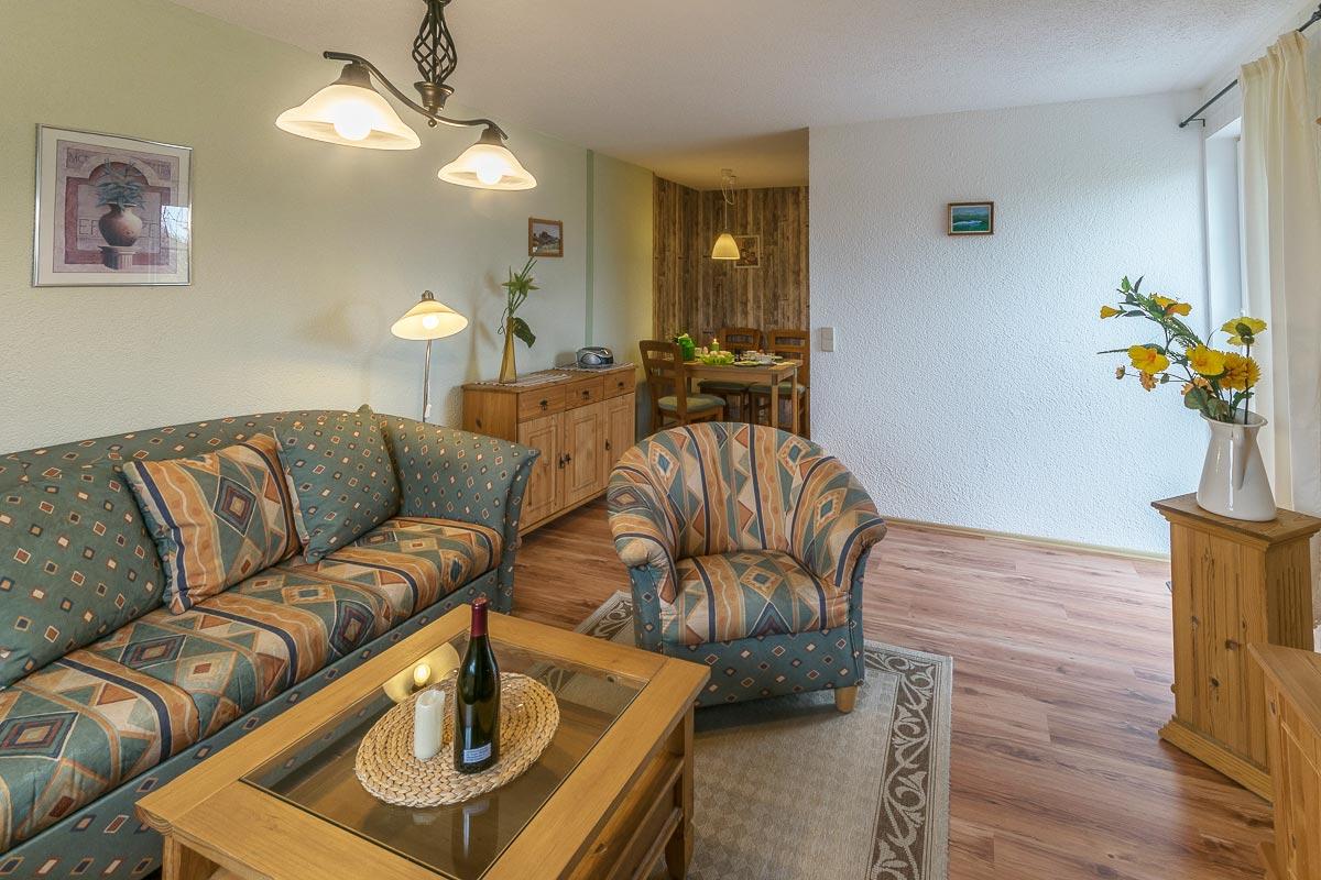 Ferienwohnung Pfaffenstein - Wohnzimmer mit Sofa